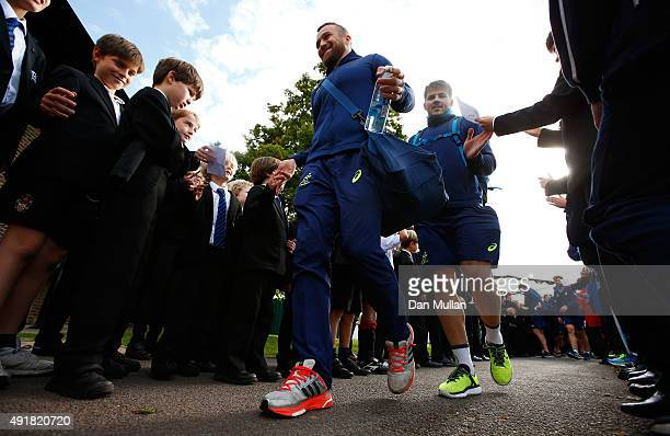 Matt Giteau of Australia and Drew Mitchell of Australia leave through a guard of honour following a training session at Dulwich College on October 8,...