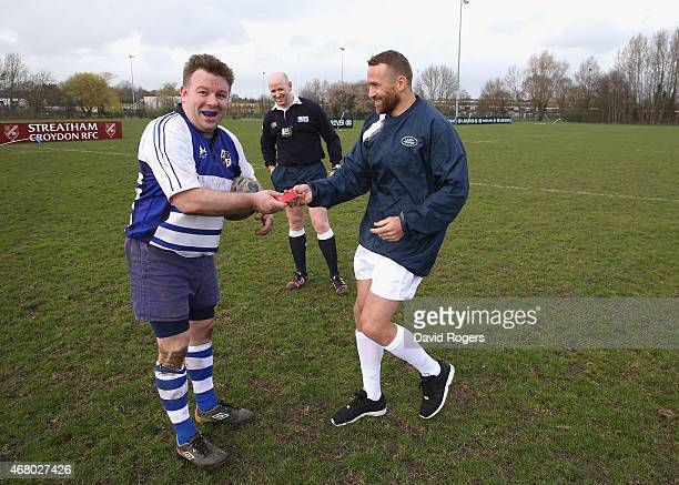 Matt Giteau of Australia and Toulon delivers the kicking tee to Robert Holmes the Racal Decca RFC kicker during the launch of the Land Rover Rugby...
