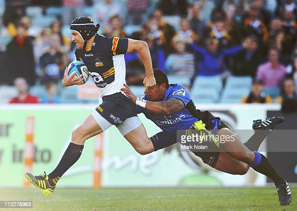 Matt Giteau of the Brumbies heads for the try line to score during the round nine Super Rugby match between the Brumbies and the Force at Canberra...