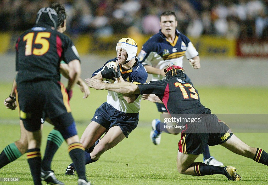Matt Giteau #12 of the Brumbies in action during the Super12 game between the Chiefs and Brumbies at Waikato Stadium in Hamilton, New Zealand on May 8, 2004. The Chiefs scored a point by finishing within 8 points of the Brumbies to go through. The Brumbies won the match 15-12.