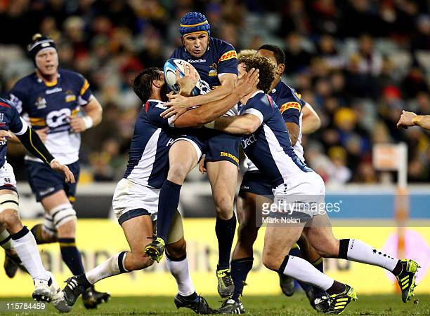 Matt Giteau of the Brumbies is tackled during the round 17 Super Rugby match between the Brumbies and the Rebels at Canberra Stadium on June 10 2011...
