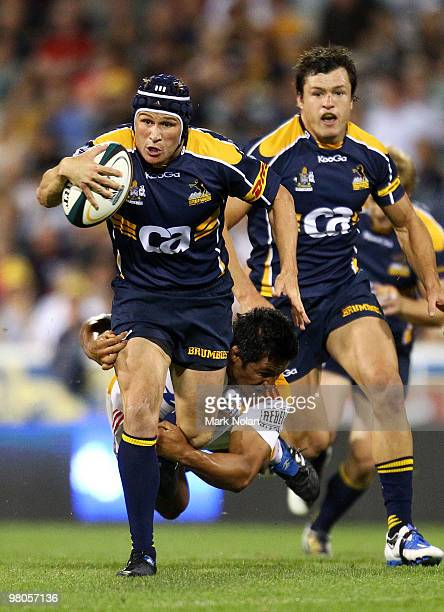 Matt Giteau of the Brumbies makes a line break during the round seven Super 14 match between the Brumbies and the Chiefs at Canberra Stadium on March...