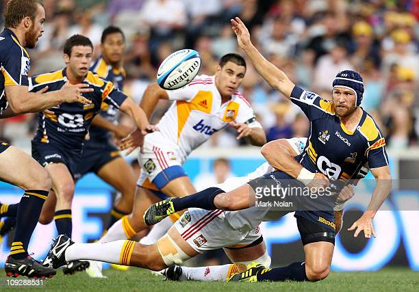 Matt Giteau of the Brumbies offloads during the round one Super Rugby match between the Brumbies and the Chiefs at Canberra Stadium on February 19...