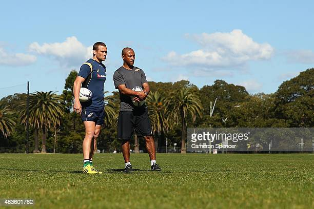 Matt Giteau of the Wallabies and former Wallaby George Gregan look on during an Australian Wallabies training session at Tramway Oval on August 11...