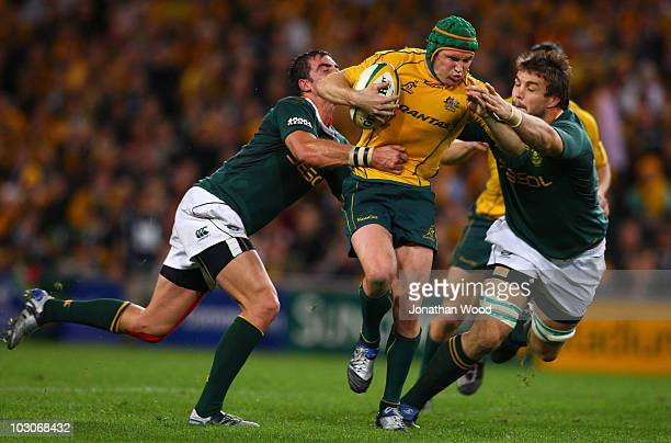 Matt Giteau of the Wallabies in attack during the 2010 TriNations match between the Australian Wallabies and the South African Springboks at Suncorp...