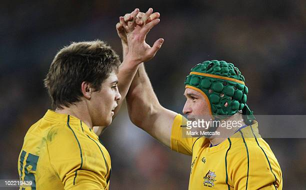 Matt Giteau of the Wallabies is congratulated by teammate James O'Connor after scoring his second try during the Cook Cup Test Match between the...