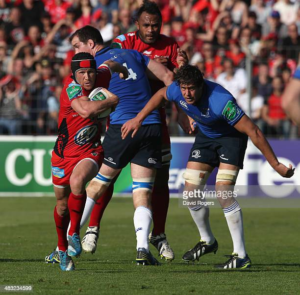 Matt Giteau of Toulon breaks with the ball during the Heineken Cup quarter final match between Toulon and Leinster at the Felix Mayol Stadium on...