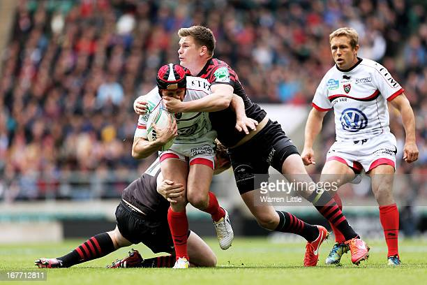 Matt Giteau of Toulon is hauled down by Owen Farrell of Saracens during the Heineken Cup semi final between Saracens and Toulon at Twickenham Stadium...