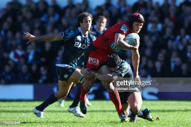 Matt Giteau of Toulon is held up by Leigh Halfpenny of Cardiff Blues during the Heineken Cup Pool Six match between Cardiff Blues and Toulon at...