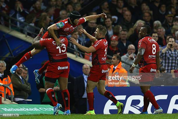 Matt Giteau of Toulon is lifted high by team mates after scoring the opening try during the Heineken Cup Final match between Toulon and Saracens at...