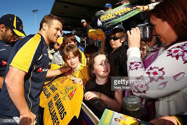 Matt Giteau poses for a photograph with fans during a Wallabies training session at St Marys League stadium on July 16 2010 in Penrith Australia