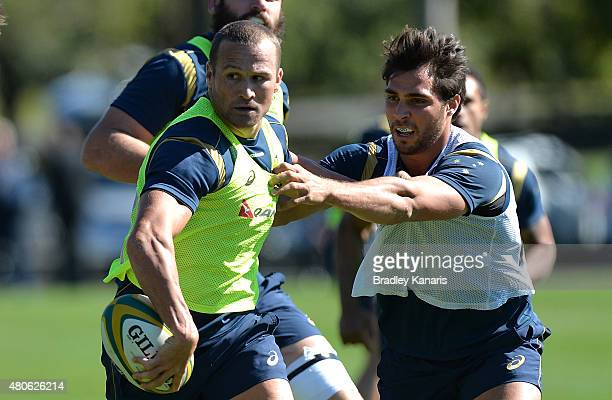 Matt Giteau takes on the defence during an Australian Wallabies training session at Ballymore Stadium on July 14 2015 in Brisbane Australia