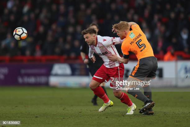 Matt Godden of Stevenage turns away from Paul McShane of Reading during The Emirates FA Cup Third Round match between Stevenage and Reading at The...