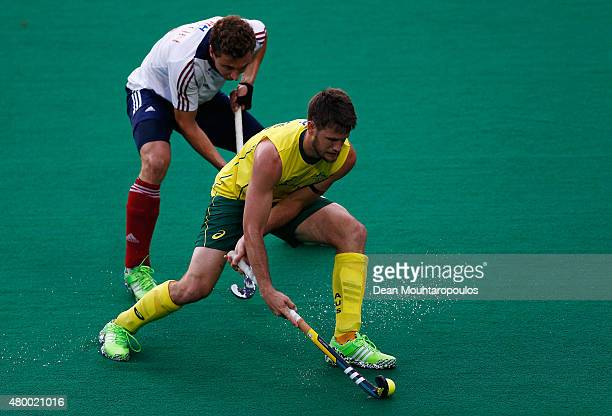 Matt Gohdes of Australia battles for the ball with Harry Martin of Great Britain during the Fintro Hockey World League SemiFinal match between...
