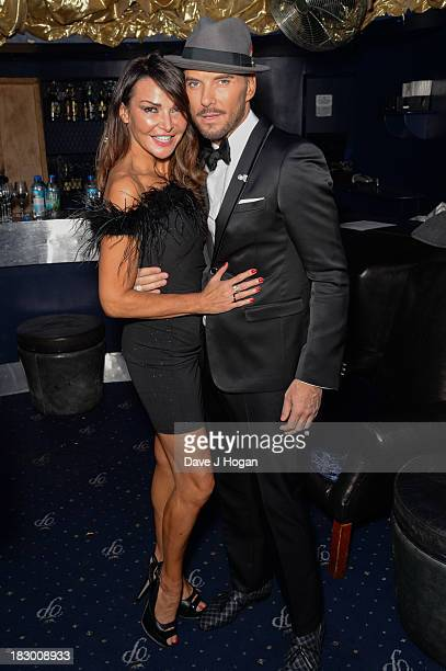 Matt Goss and Lizzie Cundy pose for a photo backstage ahead of his series of gigs which begin tonight at Cafe de Paris on October 3 2013 in London...