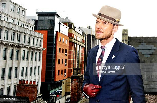 Matt Goss poses on the rooftop after meeting fans and signing copies of his new album 'Life You Imagine' at HMV Manchester on October 19 2013 in...