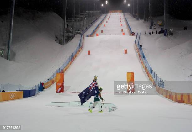 Matt Graham of Australia celebrates his silver medal in the Freestyle Skiing Men's Moguls with the Australian flag at the bottom of the moguls course...