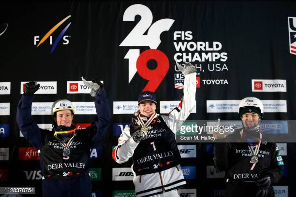 Matt Graham of Australia second place Mikael Kingsbury of Canada first place and Daichi Hara of Japan third place celebrate on the podium for the...
