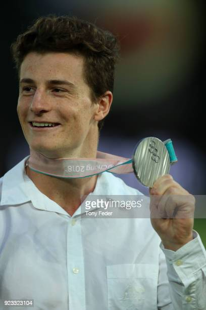 Matt Graham of Australia shows off his silver medal which he won in the mens moguls at the winter Olympics in PyeongChang during the round 21 ALeague...