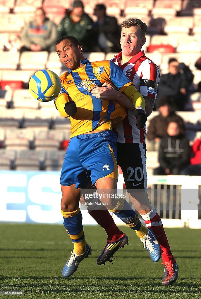 Matt Green of Mansfield Town attempts to control the ball under pressure from Tom Miller of Lincoln City during the FA Cup with Budweiser Second Round match at Sincil Bank Stadium on December 1, 2012 in Lincoln, England.