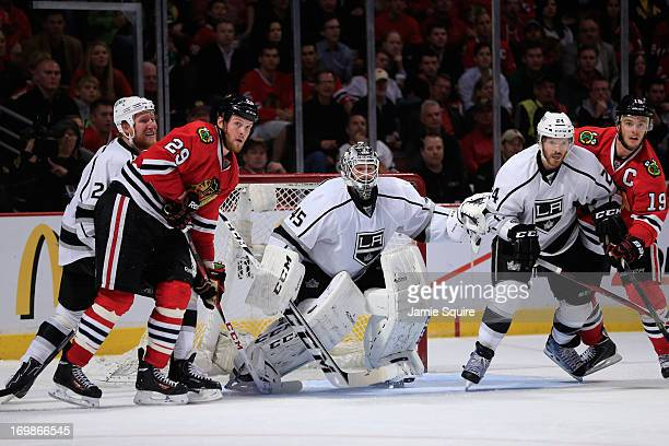 Matt Greene and Colin Fraser of the Los Angeles Kings defend Bryan Bickell and Jonathan Toews of the Chicago Blackhawks respectively as goaltender...