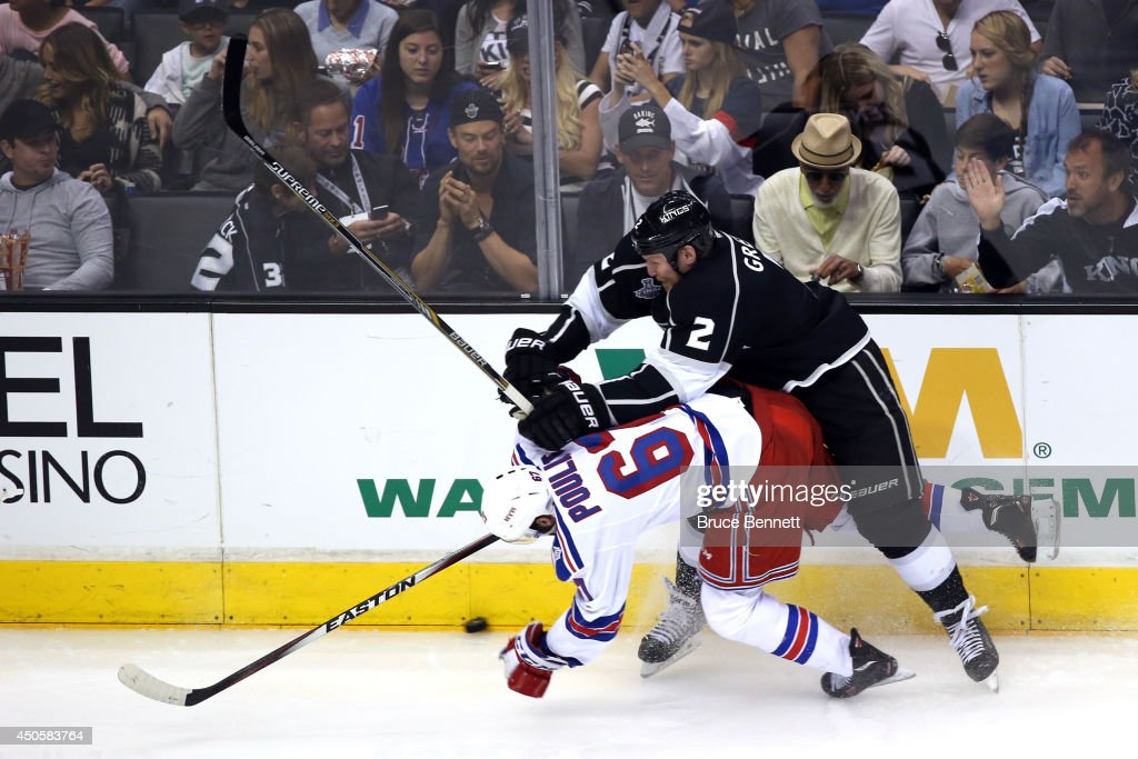 Matt Greene #2 of the Los Angeles Kings checks Benoit Pouliot #67 of the New York Rangers in the second period during Game Five of the 2014 Stanley Cup Final at Staples Center on June 13, 2014 in Los Angeles, California.