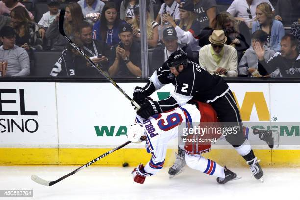 Matt Greene of the Los Angeles Kings checks Benoit Pouliot of the New York Rangers in the second period during Game Five of the 2014 Stanley Cup...
