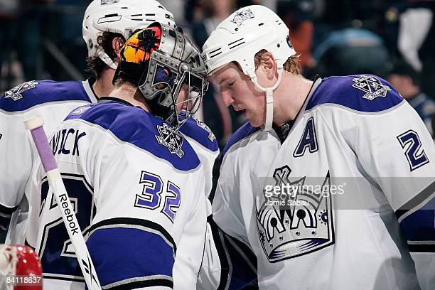 Matt Greene of the Los Angeles Kings congratulates teammate goaltender Jonathan Quick on his first win of the season and first career shutout at...