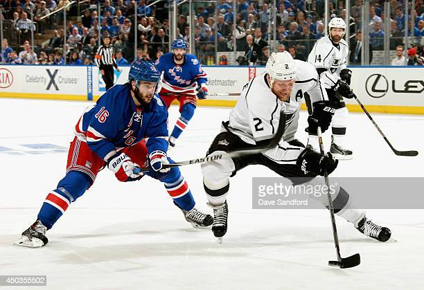 Matt Greene of the Los Angeles Kings is chased by Derick Brassard of the New York Rangers during the first period of Game Three of the 2014 Stanley...