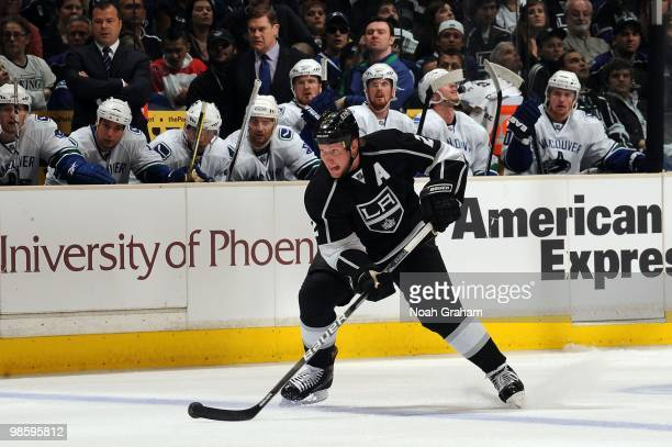 Matt Greene of the Los Angeles Kings skates with the puck against the Vancouver Canucks in Game Three of the Western Conference Quarterfinals during...