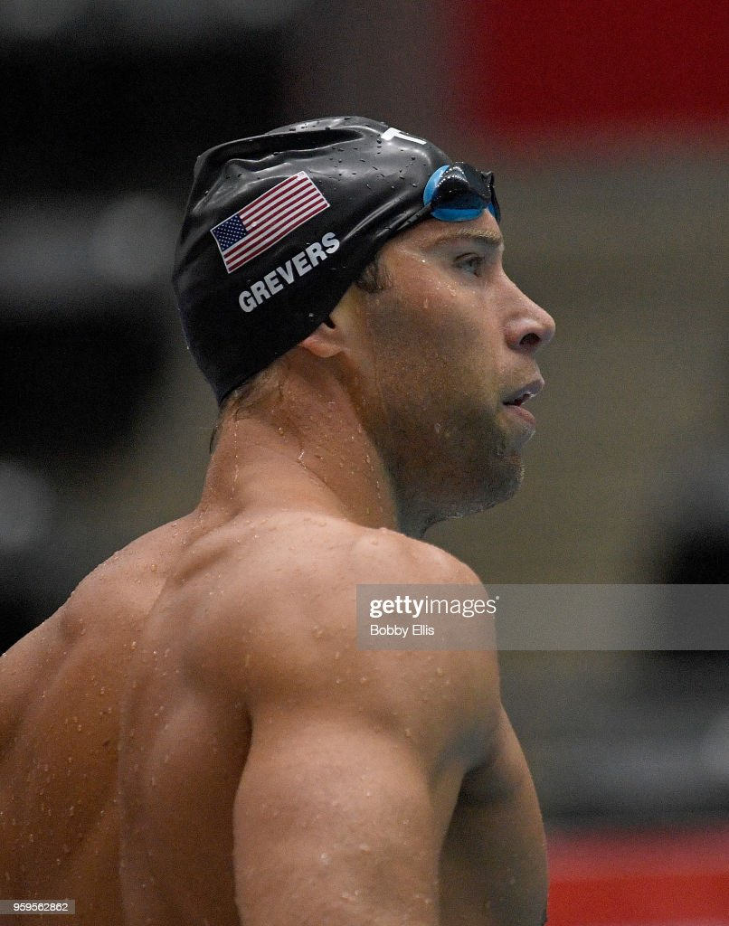Matt Grevers looks at the scoreboard following the men's 100 meter freestyle preliminary race during the TYR Pro Swim Series at Indiana University Natatorium on May 17, 2018 in Indianapolis, Indiana.