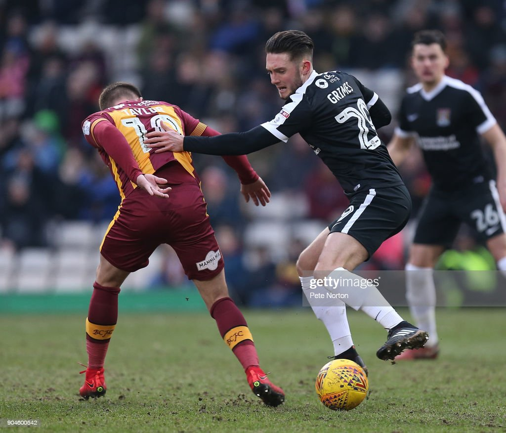 Matt Grimes of Northampton Town contests the ball with Paul Taylor of Bradford City during the Sky Bet League One match between Bradford City and Northampton Town at Northern Commercials Stadium, Valley Parade on January 13, 2018 in Bradford, England.