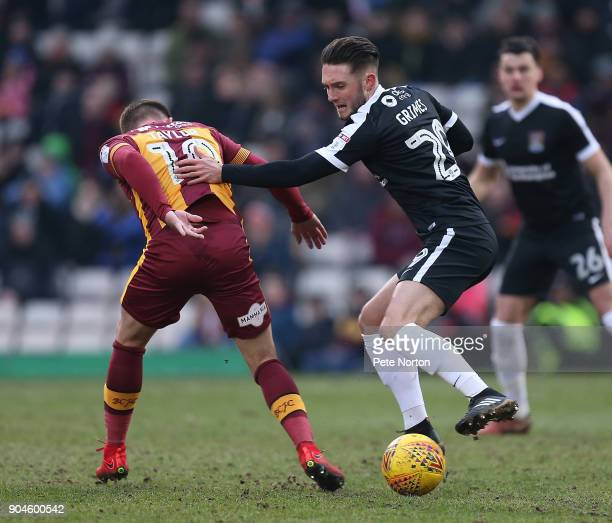 Matt Grimes of Northampton Town contests the ball with Paul Taylor of Bradford City during the Sky Bet League One match between Bradford City and...