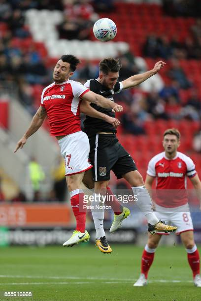Matt Grimes of Northampton Town contests the ball with Richie Towell of Rotherham United during the Sky Bet League One match between Rotherham United...