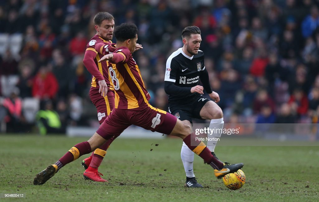 Matt Grimes of Northampton Town controlds the ball under pressure from Timothee Dieng of Bradford City during the Sky Bet League One match between Bradford City and Northampton Town at Northern Commercials Stadium, Valley Parade on January 13, 2018 in Bradford, England.