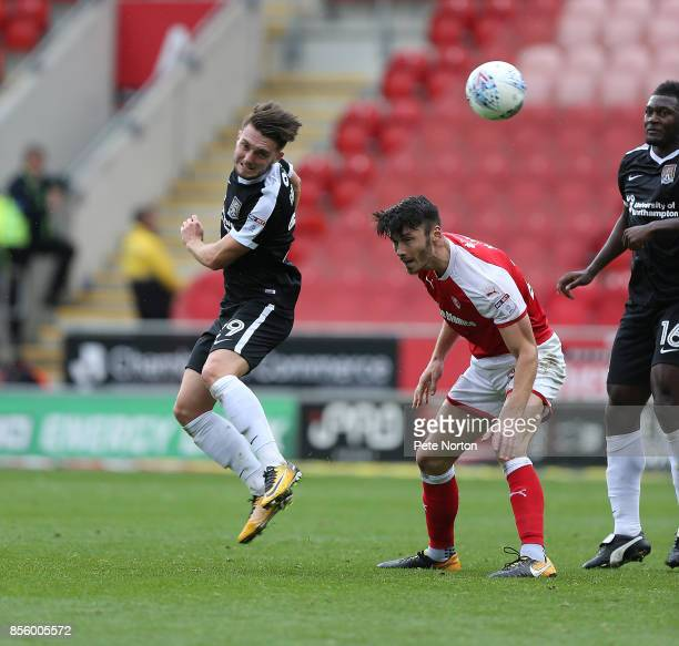 Matt Grimes of Northampton Town heads the ball away from Kieffer Moore of Rotherham United during the Sky Bet League One match between Rotherham...
