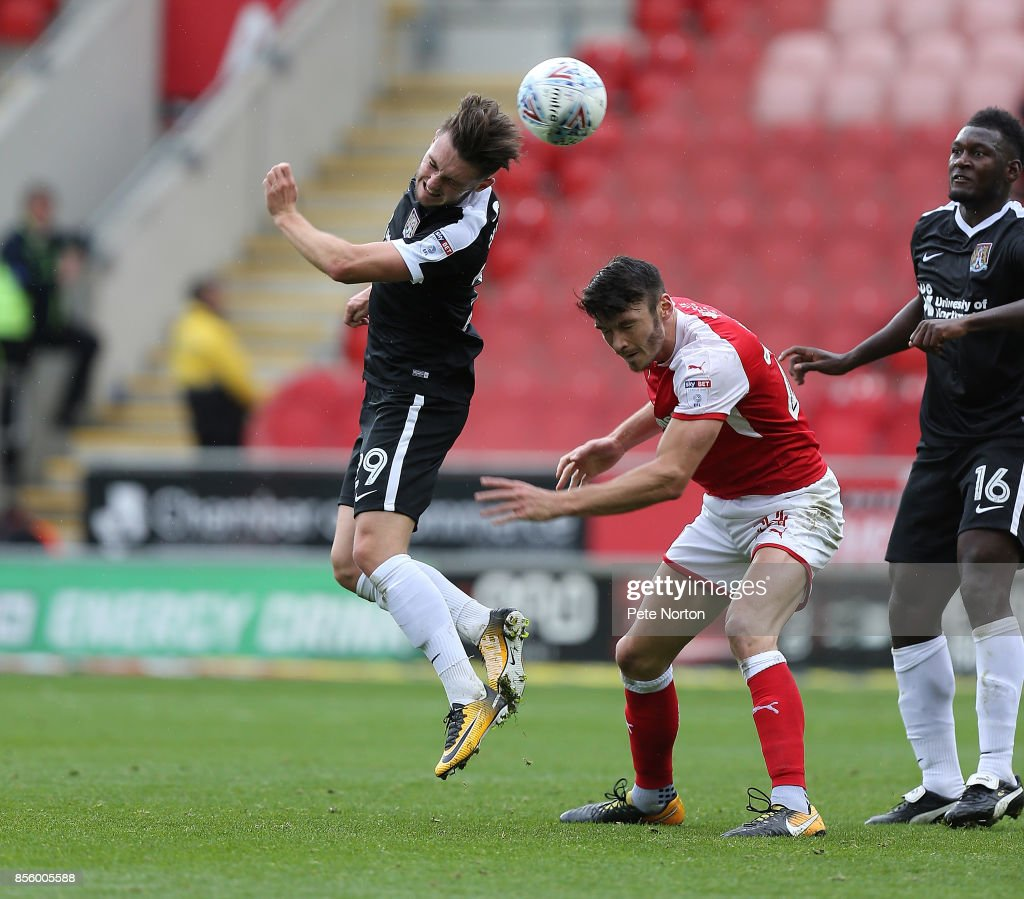 Matt Grimes of Northampton Town heads the ball away from Kieffer Moore of Rotherham United during the Sky Bet League One match between Rotherham United and Northampton Town at The Aesseal New York Stadium on September 30, 2017 in Rotherham, England.