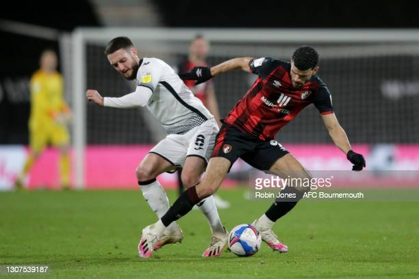 Matt Grimes of Swansea City and Dominic Solanke of Bournemouth tussle for the ball during the Sky Bet Championship match between AFC Bournemouth and...