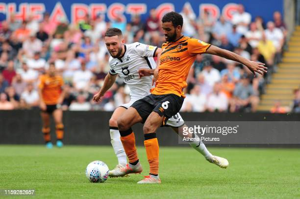 Matt Grimes of Swansea City battles with Kevin Stewart of Hull City during the Sky Bet Championship match between Swansea City and Hull City at the...