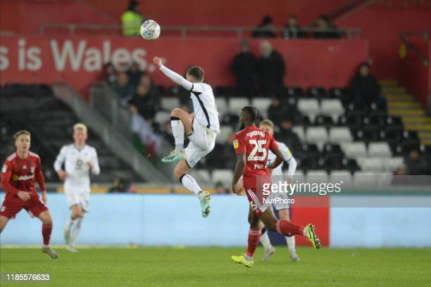Matt Grimes of Swansea City in an aerial battle during the Sky Bet Championship match between Swansea City and Fulham at the Liberty Stadium Swansea...