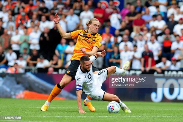 Matt Grimes of Swansea City is fouled by Tom Eaves of Hull City during the Sky Bet Championship match between Swansea City and Hull City at the...