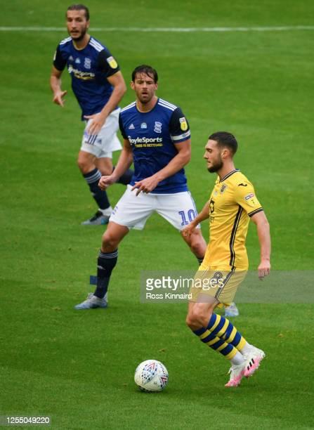 Matt Grimes of Swansea is challenged by Lukas Jutkiewicz of Birmingham during the Sky Bet Championship match between Birmingham City and Swansea City...