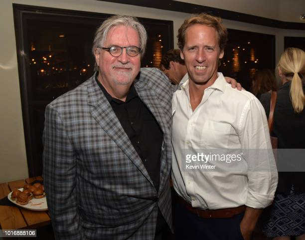Matt Groening and Nat Faxon pose at the after party for Netflix's Disenchantment at the Messhall Kitchen on August 14 2018 in Los Angeles California