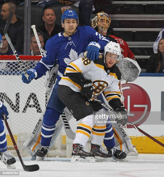 Matt Grzelcyk of the Boston Bruins battles against James van Riemsdyk of the Toronto Maple Leafs in Game Four of the Eastern Conference First Round...