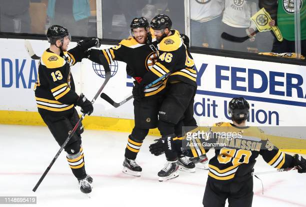 Matt Grzelcyk of the Boston Bruins celebrates with teammates after scoring a second period goal against the Carolina Hurricanes in Game Two of the...