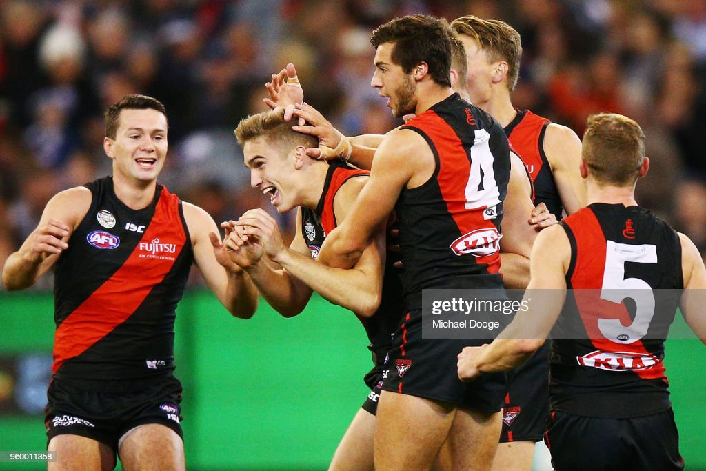 Matt Guelfi of the Bombers celebrates a goal during the round nine AFL match between the Essendon Bombers and the Geelong Cats at Melbourne Cricket Ground on May 19, 2018 in Melbourne, Australia.
