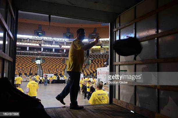 Matt Gulley with the Bruins sales department was among the Salvation Army and TD Garden volunteers helping fill up backpacks with back to school...