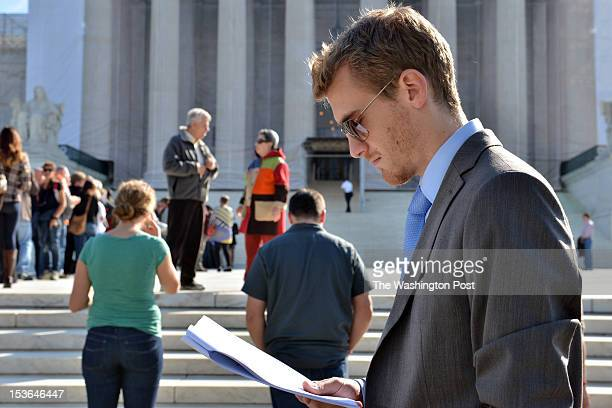 Matt Gunter of Alexandria VA studies a case while standing in line to see first hand the operations of the Supreme Court at the US Supreme Court on...