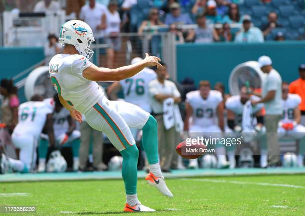 Matt Haack of the Miami Dolphins punting against the Baltimore Ravens at Hard Rock Stadium on September 08 2019 in Miami Florida