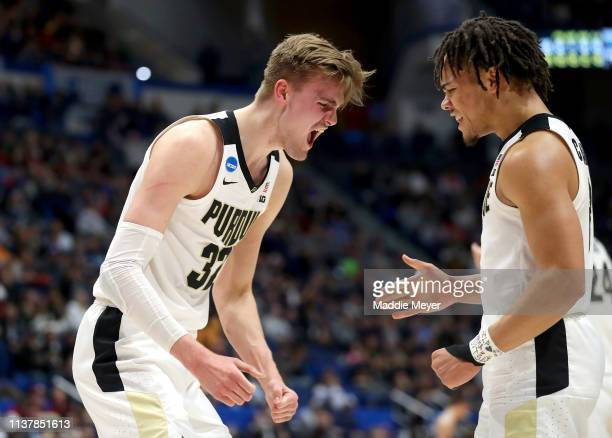 Matt Haarms and Carsen Edwards of the Purdue Boilermakers celebrate their teams lead in the first half against the Villanova Wildcats during the...